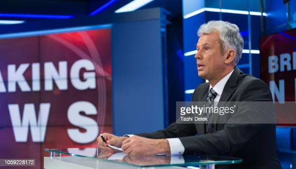 newsreader in television studio - newscaster stock pictures, royalty-free photos & images