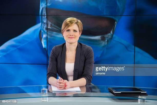 Newsreader in television studio