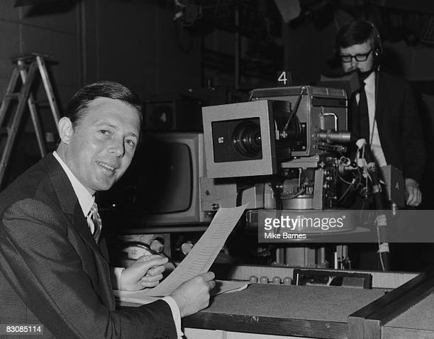 BBC newsreader Michael Aspel returns to his desk at Alexandra Palace to read the lunchtime news 8th May 1968 He had been absent for three weeks to...