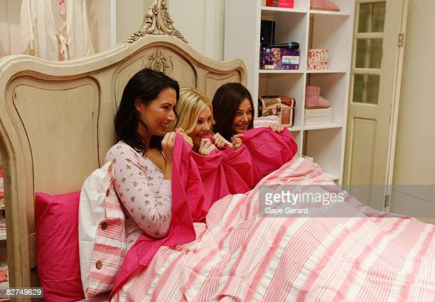 Newsreader Sara Groen Model Jamie Wright and Kirsty LeeAllan pose in bed for the launch of 'Girls Night In' at the Peter Alexander store in Pitt...