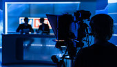 Newsreaders In Television Studio