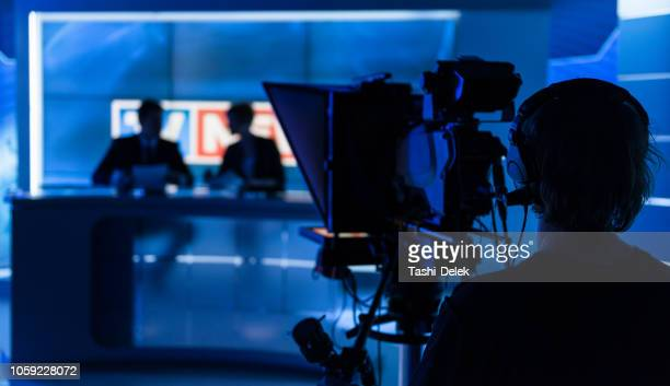 newsreaders in television studio - press conference stock pictures, royalty-free photos & images