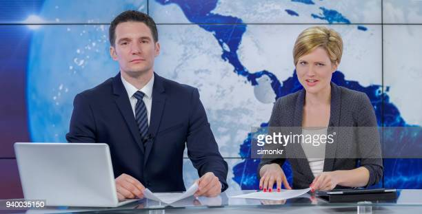 newsreaders in television studio - newscaster stock pictures, royalty-free photos & images