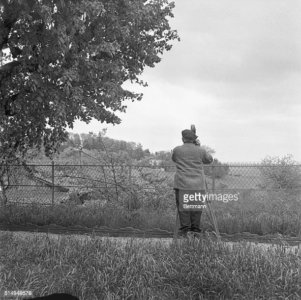 Newsreel cameraman sets his sights on the house of Gen. Charles De Gaulle in this small village in Eastern France. Newsmen have been drawn here in...