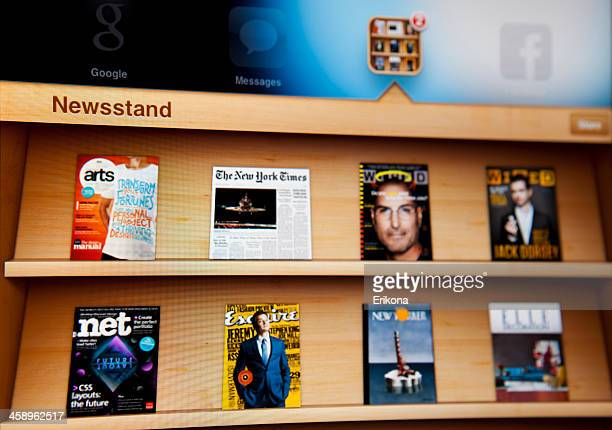 newsstand on ipad - new yorker building stock photos and pictures