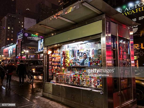 Newsstand on Manhattan with vendor and people around