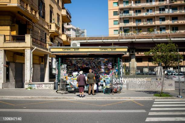 A newsstand open with some people who are preparing to buy newspapers on L'aquila street on April 7 2020 in Rome The Italian government has issued...