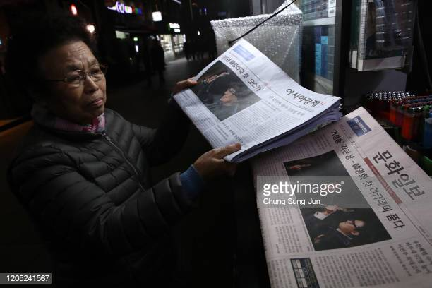A newsstand vendor collects newspapers reporting the South Korean director Bong Joon Ho on February 10 2020 in Seoul South Korea Bong Joonho's...
