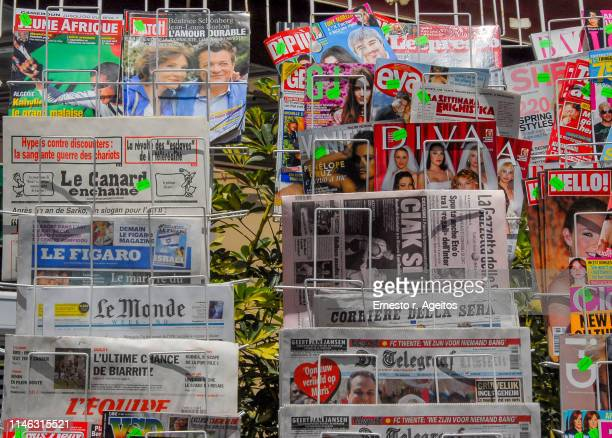 newsstand with newspapers and magazines on different languages - magazine rack stock photos and pictures