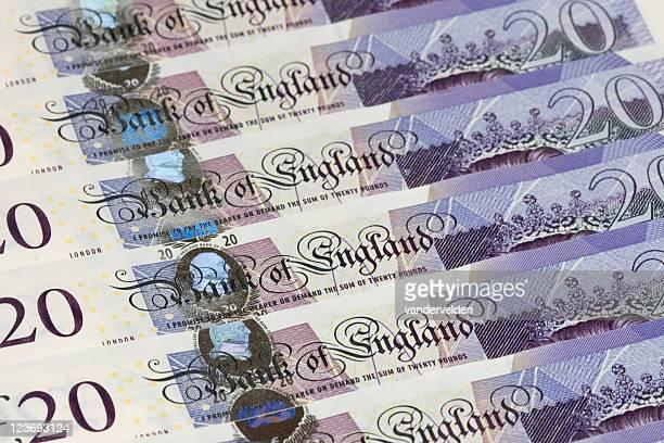 new-style twenty pound notes - twenty pound note stock photos and pictures