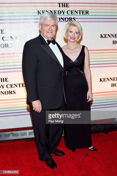 Newt Gingrich and wife Callista Gingrich arrive at the 34th Kennedy Center Honors at the Kennedy Center Hall of States on December 4 2011 in...