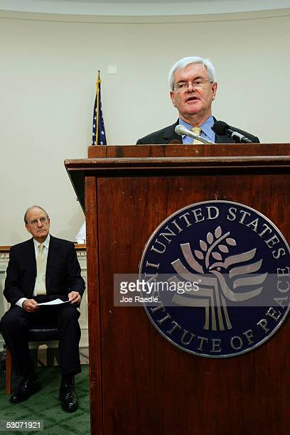 Newt Gingrich former House Speaker speaks with George Mitchell former Senate Majority Leader during a news briefing to release the task force on the...