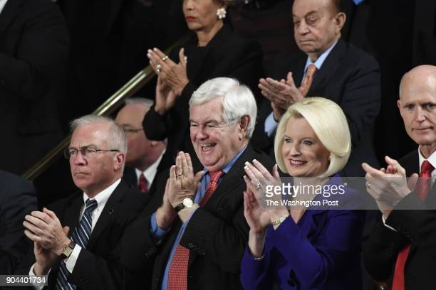 Newt Gingrich former Speaker of the United States House of Representatives and his wife Callista react during President Donald J Trumps first address...