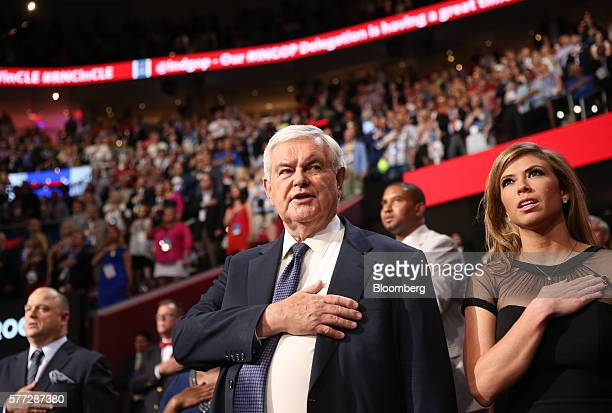Newt Gingrich former speaker of the US House of Representatives stands during the Pledge of Allegiance at the Republican National Convention in...