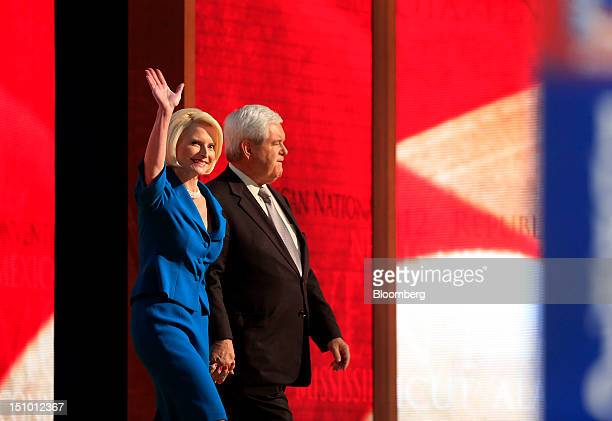 Newt Gingrich former US Speaker of the House right and wife Callista Gingrich gesture on stage before speaking at the Republican National Convention...