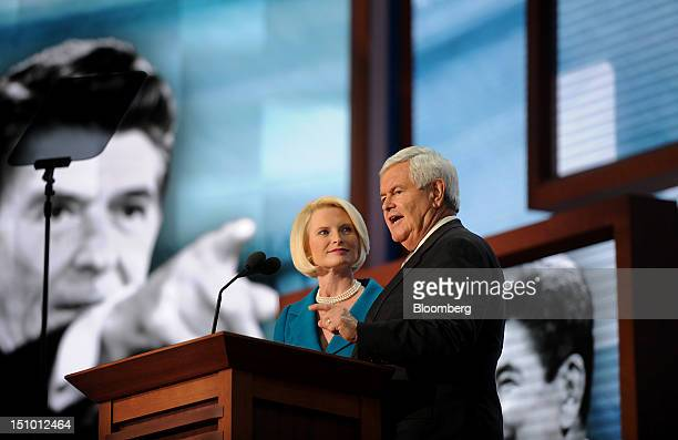 Newt Gingrich former US Speaker of the House right speaks while wife Callista Gingrich listens at the Republican National Convention in Tampa Florida...