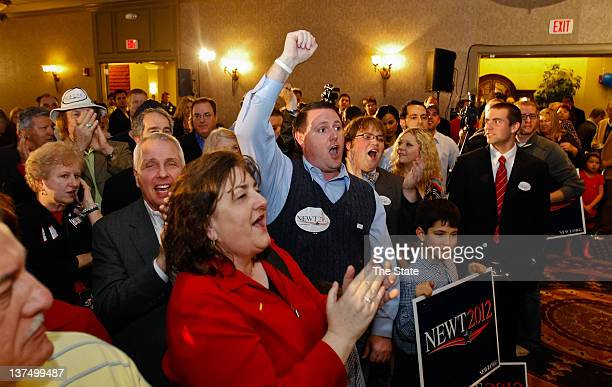Newt Gingrich supporters cheer in Columbia South Carolina after they learned that Republican presidential candidate Newt Gingrich had defeated his...