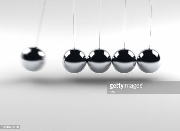 newton balls - desk toy stock photos and pictures