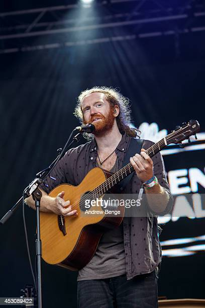 Newton Faulkner performs on stage at Kendal Calling Festival at Lowther Deer Park on August 2 2014 in Kendal United Kingdom