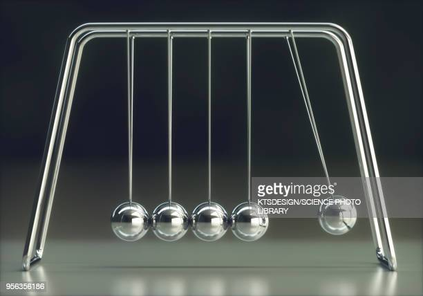 newtons cradle - desk toy stock photos and pictures