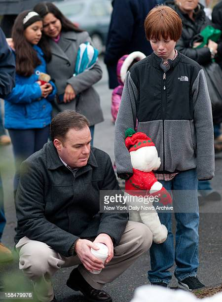 Newtown community comes together outside the firehouse to mourn the loss of 27 people including 20 children in the Sandy Hook Elementary School...