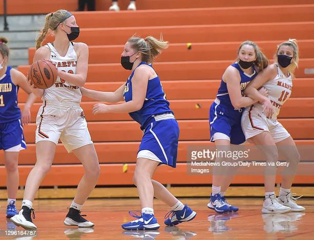 Newtown, PA. Jan. 12 : Marple Newtown's Makenzie Hilden looks to pass in the second quarter as Springfield's Rachel Conran defends in the opener of...