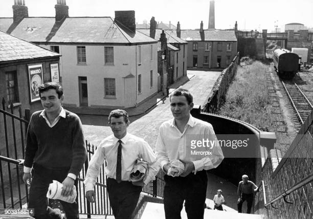 Newtown was a residential area of Cardiff Wales that existed from the midnineteenth century until it was demolished in 1970 Pictured three young men...