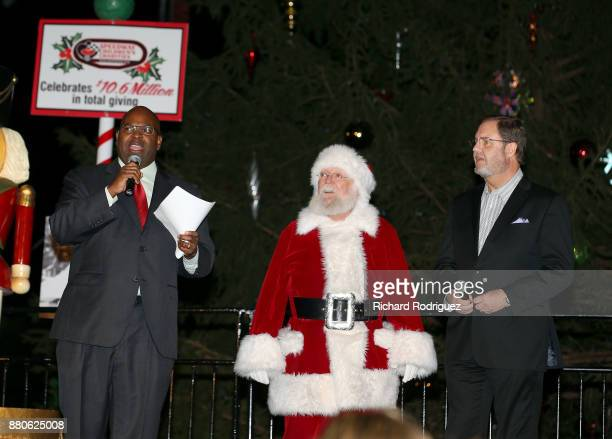 Newy Scruggs KXASTV Sports Director Santa Claus and Texas Motor Speedway President Eddie Gossage prepare to light the tree at the Speedway Children's...