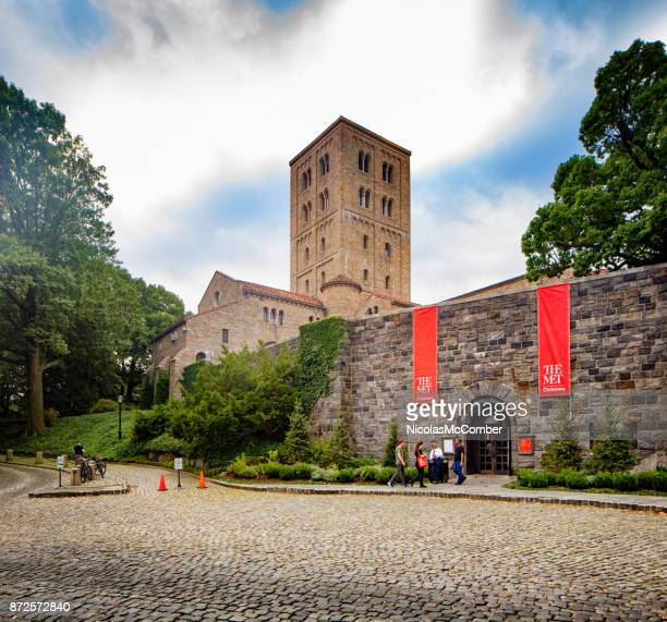 new-york city the cloisters museum main entrance with tower and banners - cloister stock pictures, royalty-free photos & images