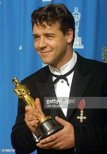 NewZealand born Australian actor Russell Crowe holds his Oscar for Best Actor for his role in Gladiator at the 73rd Annual Academy Awards at the...