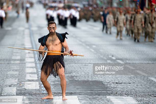 NewZealand Defence Force Maori soldier rehearses for the French day parade on the July 14 on the Avenue des ChampsElysees on July 12 2016 in Paris...