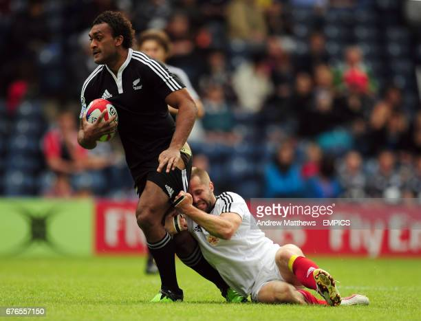 NewZealand's Save Tokula gets tackled by Russia's Andrey Bykanov