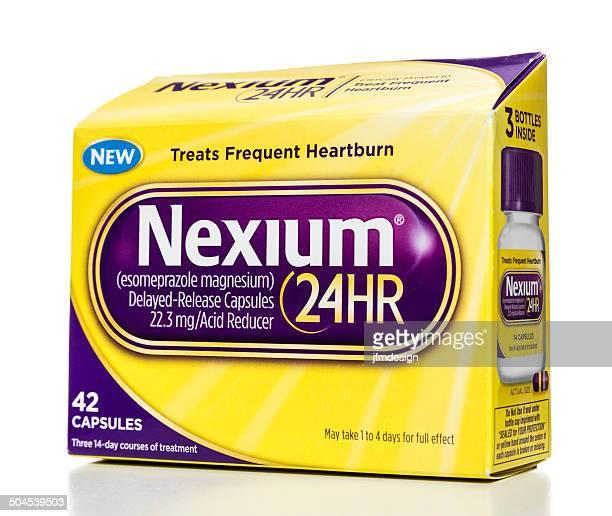 nexium 24hr 42 capsules box - heartburn stock photos and pictures