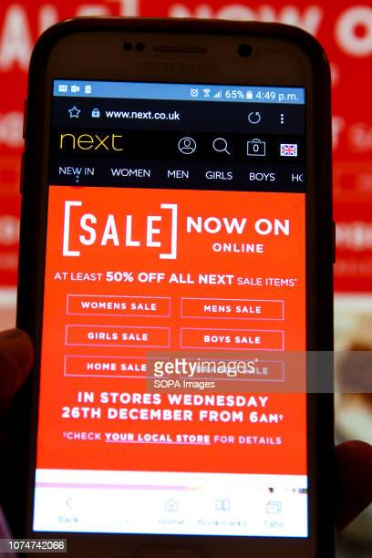 Next Boxing Day online sale is seen on a mobile phone Boxing Day online sales have begun in many high street stores as shops try to make up for weak...