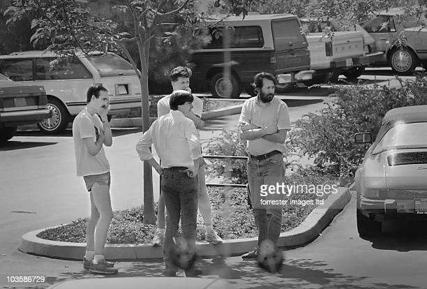 NeXT CEO Steve Jobs with NeXT employees in the parking lot of the Palo Alto offices in March 1988 VP of Digital Harware engineer Rich Page is on the...