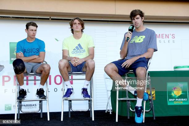 Next Gen player Reilly Opelka answers questions on the stage with Alex De Minaur of Australia and Stefanos Tsitsipas of Greece after the men's...