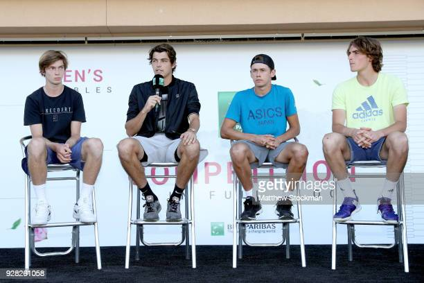 Next Gen player Taylor Fritz answers questions on the stage with Andrey Rublev of Russia Alex De Minaur of Australia and Stefanos Tsitsipas of Greece...