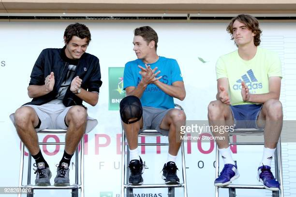 Next Gen players Taylor Fritz Alex De Minaur of Australia and Stefanos Tsitsipas of Greece wait on stage as they are introduced after the men's...