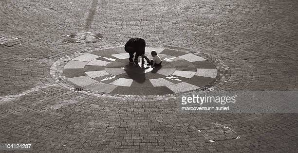 next generation is centre of the world - compass rose - west direction stock pictures, royalty-free photos & images