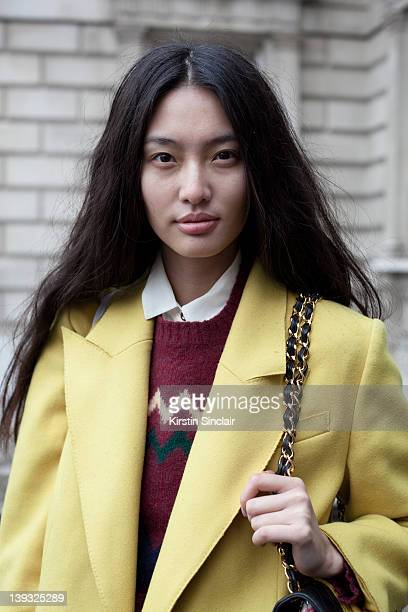 Next Model Bonnie Chen wearing Dolce and Gabbana Jacket vintage sweater LA Bouique skirt Urban Outfitters boots vintage chanel bag street style at...