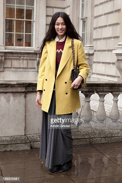 Next model Bonnie Chen wearing Dolce and Gabbana jacket vintage sweater LA Boutique skirt Urban outfitters boots Vintage chanel bag street style at...