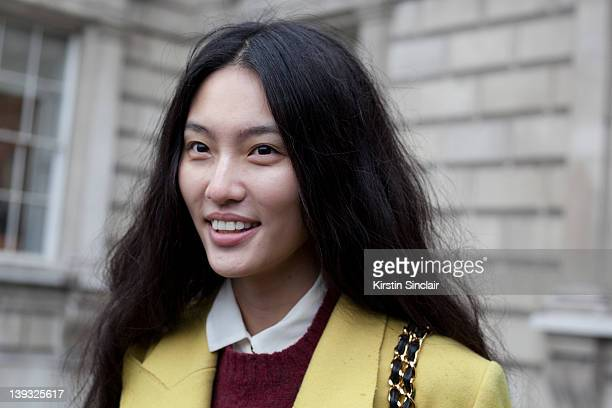 Next model Bonnie Chen wearing Dolce and Gabbana jacket Vintage sweater Vintage chanel bag street style at London fashion week autumn/winter 2012...