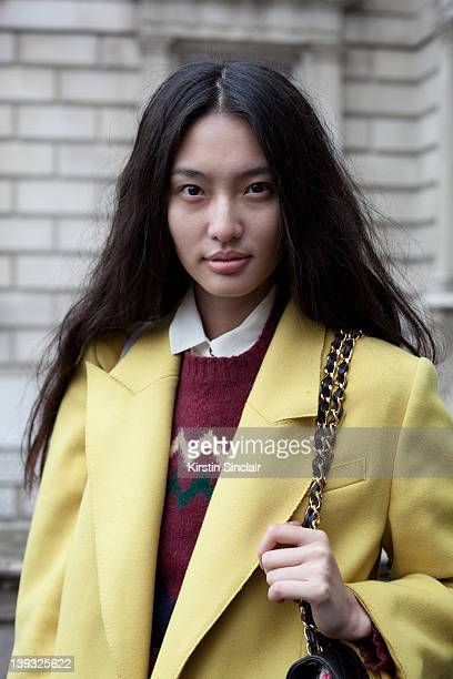 Next model Bonnie Chen wearing Dolce and Gabbana jacket Vintage sweater Urban outfitters boots vintage chanel bag street style at London fashion week...