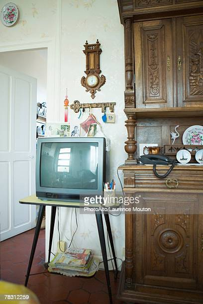 TV next to china cabinet in living room