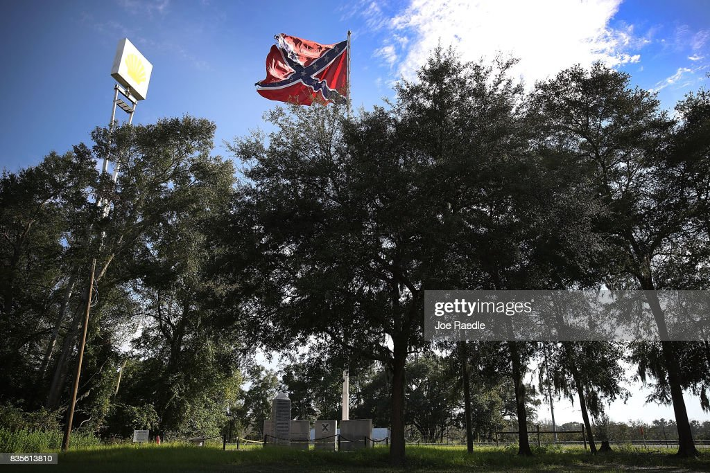 Next to Interstate 75 a Confederate Battle flag is seen as it flies above a monument erected in 2002 by the Florida Division of the Sons of Confederate Veterans in living memory of their ancestors in the midst of a national controversy over whether Confederate symbols should be removed from public display on August 19, 2017 in White Springs, Florida. The issue is at the heart of a debate about race in America and a recent protest in Charlottesville, VA turned deadly as white-supremacists clashed with counter-demonstrators over a confederate statue.