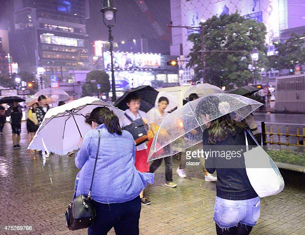 next to shibuya (zebra) crossing at night in typhoon rain - torrential rain stock pictures, royalty-free photos & images
