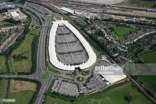 Next to the M20 is the Richard Rogers cutting edge Designer Outlet shopping Centre at Ashford in this aerial photo taken on 30th June 2006