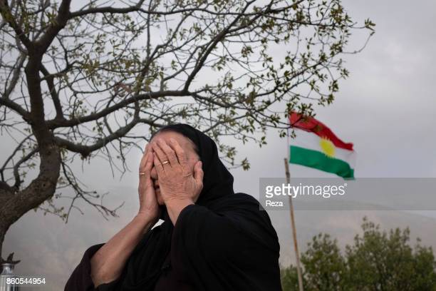 Next to the village graves have been dug for the Kurds that were killed during the Anfal a series of genocide campaigns Saddam Hussein led from...