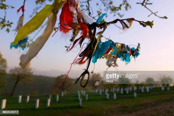 Next to the village tombs have been dug for the Kurds killed over the course of the Anfal a series of genocide campaigns Hussein led from February to...