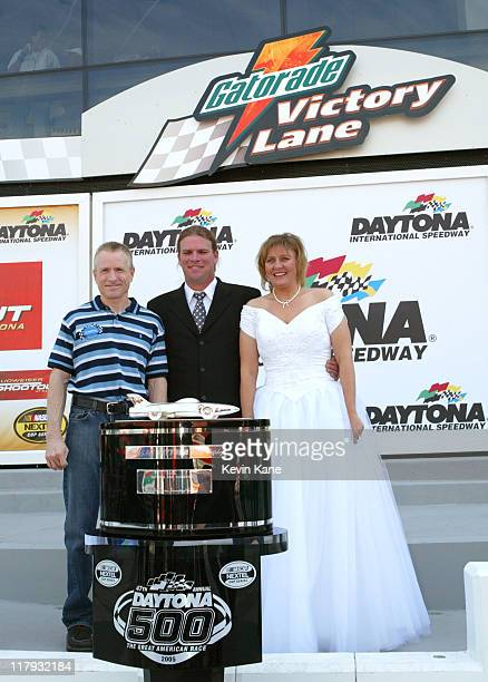 Nextel Cup Driver Mark Martin poses with Survivor's Vanuatu Islands of Fire Winner Chris Daugherty and his new bride Lorie Groves